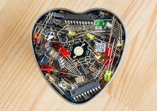 The heart of electronic technology. Metal heart with electronic elements Royalty Free Stock Photography