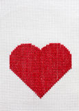 Heart embroidered cross Stock Photos