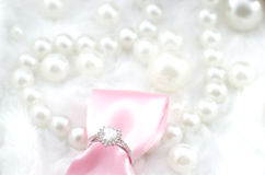 Heart engagement diamond ring with pink ribbon Royalty Free Stock Photos