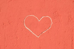 Heart engraved in the wall Stock Photos