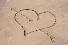 Heart engraved on the wet sand Royalty Free Stock Image