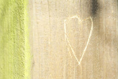 Heart engraved on woodm. Incised Heart in Wooden plank Stock Photography