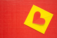 Heart envelope paper on red background Royalty Free Stock Photography