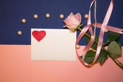 Heart envelope with a rose and pearls stock photo