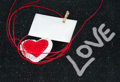 Heart of fabric on a black background. Symbol of love. Stock Photography