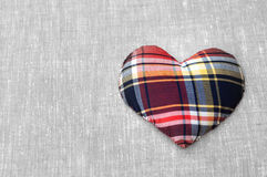 Heart of fabric on the linen cloth Royalty Free Stock Photography