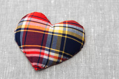 Heart of fabric on the linen cloth Royalty Free Stock Images