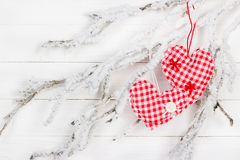 Heart of fabric on a snowy branch Stock Photography