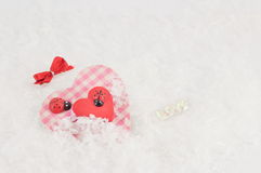 Heart in fake snow Stock Photos