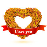 Heart of fall leaves and red ribbon banner. With text Royalty Free Stock Images