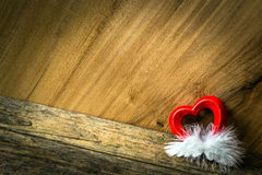Heart and feather Stock Images