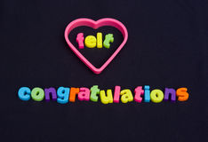 Heart felt congratulations. An image of the message in colorful lower case text ' heart felt congratulations ' set upon a dark background Stock Photography
