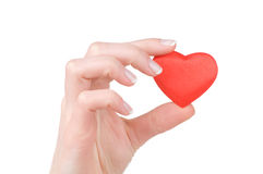 Heart in a female hand isolated on white Royalty Free Stock Photos