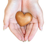 Heart in female hands Royalty Free Stock Images