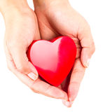 Heart in female hands. Heart in hand as love and health symbol over white Stock Images