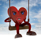 Heart figure swings on seesaw in the sky Stock Image