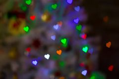 Figured bokeh heart. Heart figured New Year`s colourful bokeh with blur on dark background Royalty Free Stock Photo