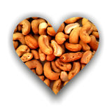 Heart filled with cashews. Heart shape with shadow, filled with cashews texture stock illustration