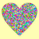 A heart filled with confetti on light yellow Stock Image