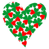 Heart filled with four-leaf clovers Royalty Free Stock Image