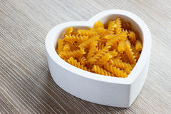 Heart filled with fusilli pasta Royalty Free Stock Image