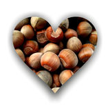 Heart filled with hazelnuts. Heart shape with shadow, filled with hazelnuts texture vector illustration