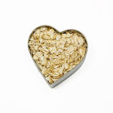 Heart filled with oatmeal. Top down view of a heart filled with oatmeal stock photos