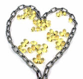 Heart filled with omega 3 Royalty Free Stock Photos
