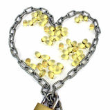 Heart filled with omega 3 Stock Photos