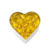 Heart filled with salmon oil Royalty Free Stock Photography