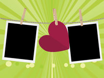 Heart with Film Frame on Rope. Retro photo frame and hearts on a rope with pegs Stock Image
