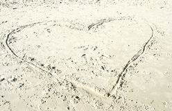 Heart in the fine sand Royalty Free Stock Photos