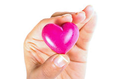 Heart in fingers. Heart in hand as love and health symbol over white Royalty Free Stock Photography