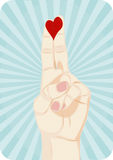 Heart on fingers. Red heart drawn on fingers Stock Image