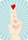 Heart on fingers stock image