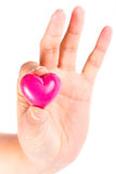 Heart in fingers over white. Heart in hand as love and health symbol over white Stock Image