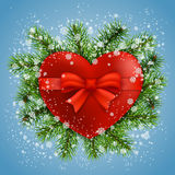 Heart in fir branches and snow. Red heart in fir branches with snow on blue background. Vector greeting card Stock Images