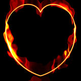 Heart Of Fire. Fiery, hot fire flames on heart shaped border on black background and copy space Stock Images