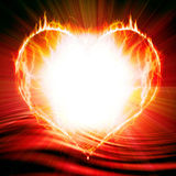 Heart on fire. On a red background Stock Photos