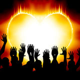 Heart on fire. With some celebrating people Stock Photos