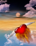 Heart on Fire. A single burning heart flies toward an unknown destination into the twilight Stock Photography