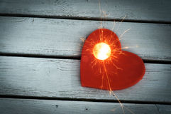 Heart Firework. On wooden background Stock Image