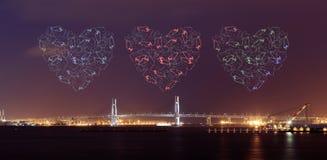 Heart Fireworks celebrating over Yokohama Bay Bridge at night Royalty Free Stock Image