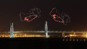 Heart Fireworks celebrating over Yokohama Bay Bridge at night Stock Images