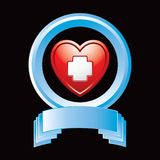 Heart with first aid icon in blue display Stock Image
