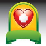 Heart with first aid icon in green display. Green and yellow display with a first aid icon in a red heart Stock Photos