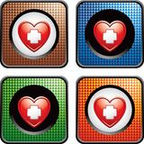 Heart with first aid icon in multicolored web icon. Various colored web buttons with a first aid icon in a red heart Stock Images