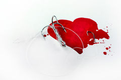 Heart and fish-hook. Conceptual background Royalty Free Stock Photography