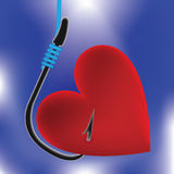 Heart on fishing hook Stock Image