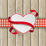 Heart Flag Double Cloth Valentinsday Wood. White paper emblem with checked towel on the wooden background Royalty Free Stock Image